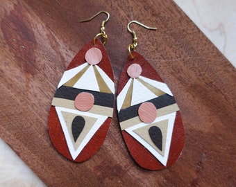 hand cut geometric adobe reds x southwestern desert x golden, tans, coral and chocolate brown polyurethane earrings.