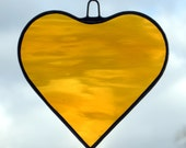 Stained Glass hanging ornament (Love Heart) in rich amber rippling water glass