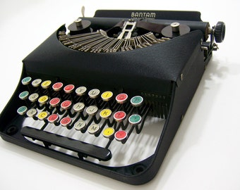 Typewriter w/colored glass chrome keys, Bantam Rem educational toy for children & beginners w/case for office, poet writer author gift idea
