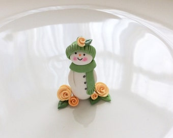 Miniature polymer clay snowman in sage green and peach hand made