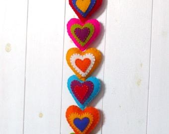 Colorful felt hearts wall hanger - 9 stuffed hearts