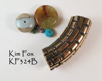 Curved Magnetic Clasp with Brick Pattern in bronze designed by Kim Fox