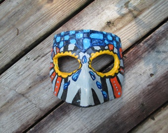 blue tears, hand sculpted paper mache clay abstract art male Masquerade mask, Halloween, black orange blue and yellow and grey colors