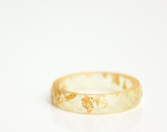 size 7.5  thin multifaceted eco resin ring | pale gold resin featuring gold metallic flakes