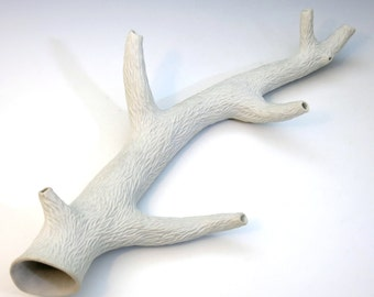 Porcelain faux carved white branch with side branches, unglazed, faux bois