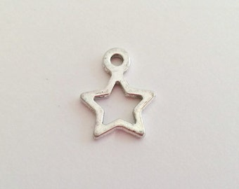 10 Antique Silver Tone  Open Star Charm Pendants H0789