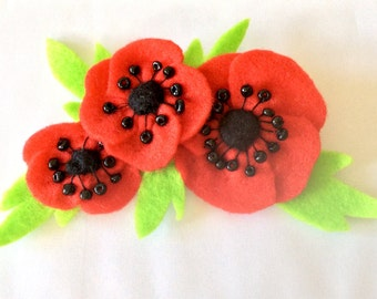 Red poppy felt corsage with embroidery, hand beading and embellishment.