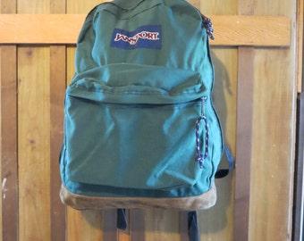 Vintage green Jansport backpack with leather bottom