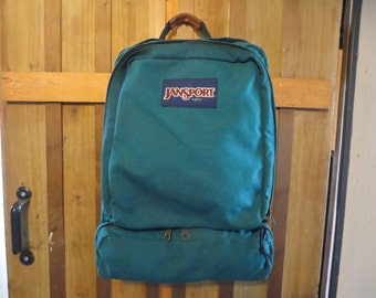 Vintage Jansport backpack  Jansport that is teal green with a bottom pouch for extra storage