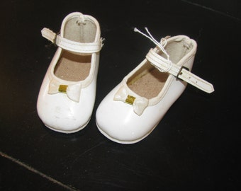 Vintage white patent baby shoes with little bows