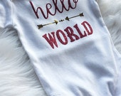 Baby girl one piece.New baby.vinyl heat bonded.singlet.Baby shower gift.Photo shoot.Hello World.Pink and silver.Glitter one piece.Baby gift