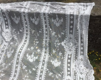 Antique French exsquist embroidered on net lace curtain