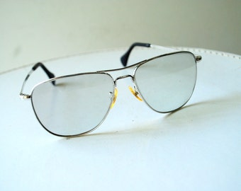 Classy vintage 70s stainless steel aviator sunglasses with a light  tinted. Made by American Optical.