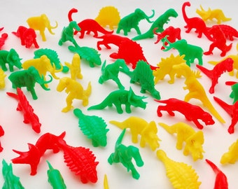Vintage 1970's Lot of 57 Vintage Plastic Dinosaurs -  Solid Molded Plastic Prehistoric Figures - Bright Colorful Red Yellow Green