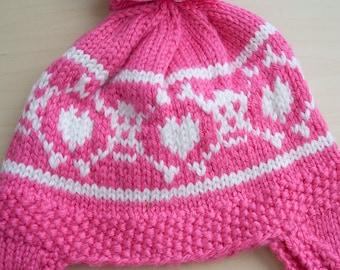 Pink skull and cross bones hat