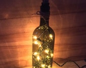 Wine bottle light/clear white lights in bottle light/ accent light/ night light/ nite lite/ dark Amberbottle with silver grape cluster top
