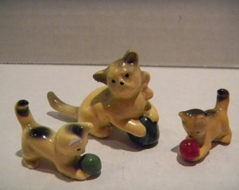 Unusual vintage miniature cat and kitten figurines...I believe coated chalk..old and interesting