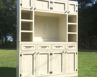 Built in entertainment center/custom tv cabinet made from all hardwood