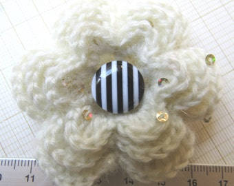Irish crochet flower brooch in cream mohair with sequins and striped button centre