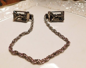 Vintage Silver Sulky Racing Sweater Clips to keep the sweater on your shoulders