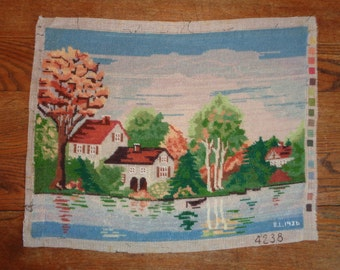 Vintage Needlepoint Sampler Tapestry of a Cottage near a River's Stream in Very Good Condition, signed and dated by B.L. in 1986