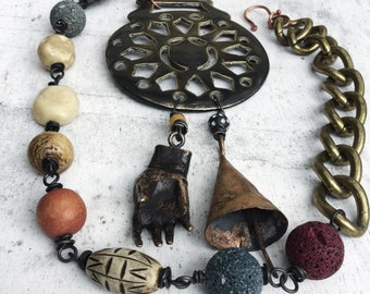 Tribal assemblage necklace with large brass focal and brass hand, rustic tribal beads, artisan necklace, statement necklace