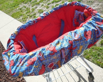 Clifford the big red dog themed Shopping Cart cover, including drawstring tote bag
