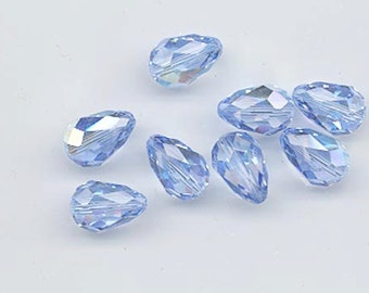 Eight vintage Swarovski crystal beads - Art. 5500 - 13.5 x 9 mm - light sapphire AB