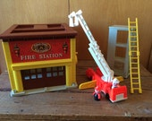 Vintage Fisher Price Fire Station 982 Includes Fire Station Fire Truck with Extending Ladder Practice Tower Ladder and Two Firemen