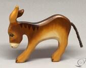 Toy donkey foal baby wood brown head down   Size: 9,0x 8,0  x 1,8 cm (bxhxs) approx. 31,0 gr.