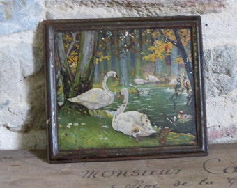 French tin lid with swans in woodland scene for home decor