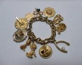 Vintage 1960's HobCo House of Borvani Gold Designer Novelty Charm Bracelet Love and Luck