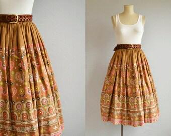 Vintage 1950s Skirt / 1950s Novelty Floral Ethnic Folk Border Print Circle Skirt / Caramel Pink Patterned Skirt