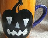 Halloween ceramic mug with black chalkboard paint Jack O'Lantern.