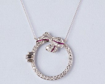 Antique 1900's Platinum Diamond and Ruby Round Bow Pendant