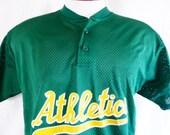 vintage 90's Oakland Athletics 10 MLB Major League Baseball dark green baseball mesh jersey henley collar men women unisex graphic t-shirt M