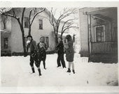 Old Photo Teen Boy and Teen Girls outside in snow Houses Trees Snowing 1920ss Photograph snapshot vintage