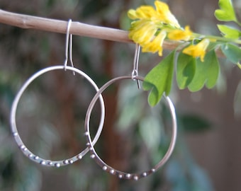 Silver hoops with dewdrops