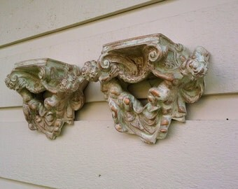 Cherub, Angel Wall shelves, set of two vintage that have been aged with paint and wax, verdigris, gold and off white, cast plaster