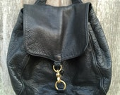 Libaire luxury black pebble leather backpack bag purse, brass trim, made in Berkeley, boho chic, 1990's era