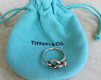TIFFANY & CO 18k (750) and 925 Love Knot Retired Weight is 3.1 grams and Size 5