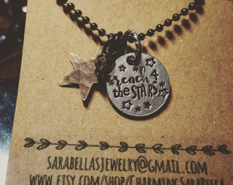 Reach for the stars necklace; mixed metal charm necklace