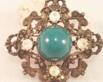 Vintage 1950s brass filigree and green glass brooch
