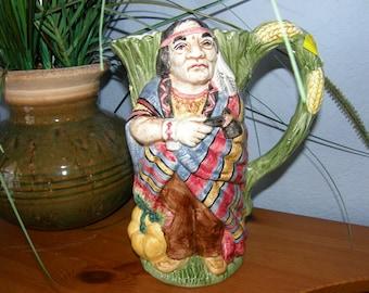 "CERAMIC PITCHER Native American Indian North American - 9"" In native dress with tomahawk, corn, pumpkin,"
