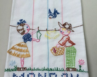 Monday tea or kitchen towel - hanging clothes on the line