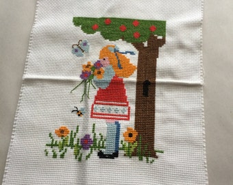 girl with flower cross stitch