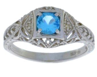 Blue Topaz & Diamond Round Ring .925 Sterling Silver