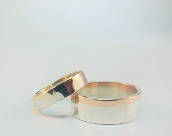 A Pair of Silver and Gold Wedding Bands