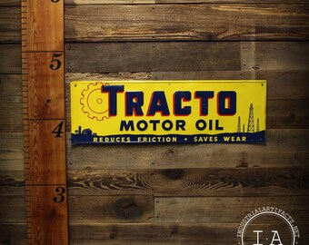 Vintage Tracto Motor Oil Embossed Tin Advertising Sign