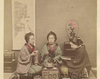Three pretty women drinking tea reading antique hand tinted albumen photo